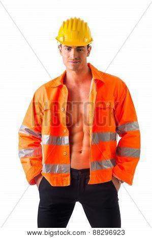 Handsome young construction worker with orange suit open