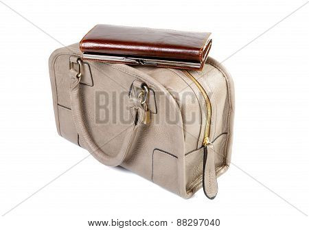 Women's Purse Is On Top Of The Bag Isolated