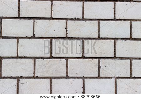 Brick wall of bricks with white