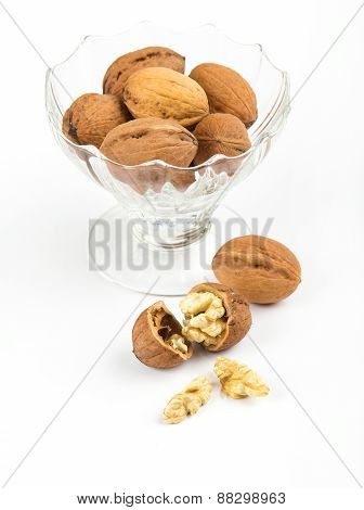 Open Walnuts In Dish Closeup On White Background
