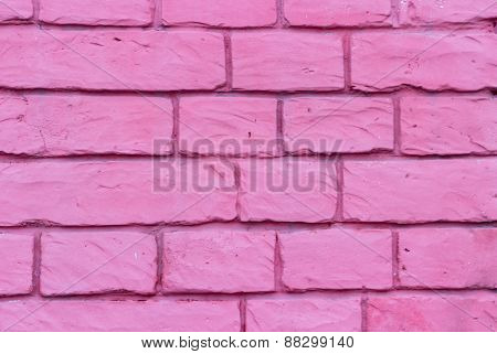 Brick wall of bricks purple streaks