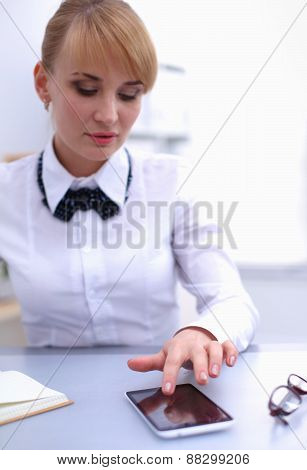 Woman in office using mobile phone