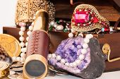 stock photo of treasure  - Pirate treasure chest with pearls jewels coins and glass - JPG