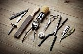 stock photo of barber  - Set of vintage barber tools on wood desk - JPG