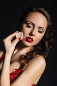 foto of red lingerie  - Portrait of a girl in red lingerie with red lips - JPG