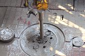 stock photo of drilling platform  - Drill pipe and Top Drive on the rig floor while making up for drilling with dirty water based mud - JPG
