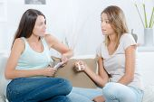 pic of pregnancy test  - Two women looking at pregnancy test - JPG