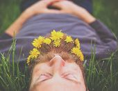 picture of lie  - a sleeping hipster lying in tall grass with dandelions in his epic beard taking a nap toned with a retro vintage instagram filter and light leaks  - JPG