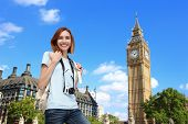 stock photo of freedom tower  - Happy woman travel in London with Big Ben tower caucasian beauty - JPG