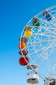 pic of color wheel  - Detail of a colorful ferris wheel seen on a fair - JPG