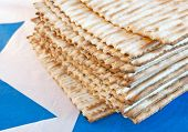 stock photo of passover  - Traditional unleavened bread for Passover on the background with the Star of David - JPG