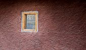 picture of single  - Single wall with brown texture and a single unopened window - JPG