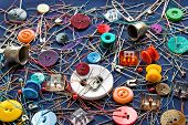 foto of blue things  - A plenty of sewing small things on a dark background - JPG