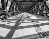 picture of girder  - Metal girders create big contrast shadows in in black and white - JPG