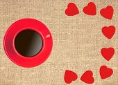 stock photo of canvas  - Border frame of red hearts and coffee cup on sack canvas burlap background texture - JPG