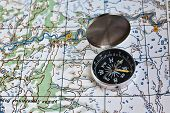 picture of compasses  - Geographical map and a compass - JPG