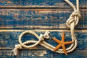 picture of starfish  - Blue wooden background with starfish and marine rope - JPG