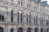 foto of scaffold  - Historic building under construction surrounded by scaffolding - JPG