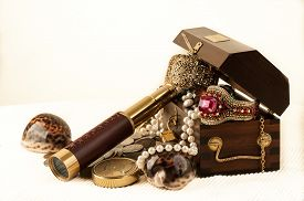 foto of pirates  - Pirate treasure chest with pearls jewels coins and glass - JPG