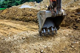 foto of power-shovel  - Close up of Digger excavator bucket bulldozer - JPG