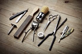 stock photo of barber razor  - Set of vintage barber tools on wood desk - JPG