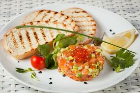 stock photo of tartar  - Salmon Tartar over White Background - JPG