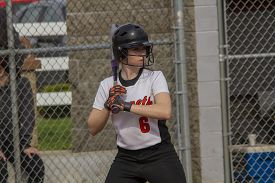 stock photo of fastpitch  - A female fastpitch softball batter sizing up the pitcher - JPG