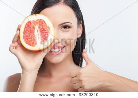 Attractive young girl is taking care of her skin