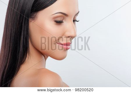 Attractive young woman is showing her healthy body