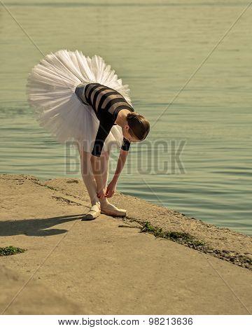 Ballerina Straightens Pointes