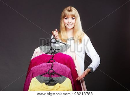 Woman Customer Holding Hangers With Clothes