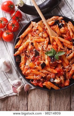 Italian Food: Pasta Alla Norma Close-up And Ingredients. Vertical Top View