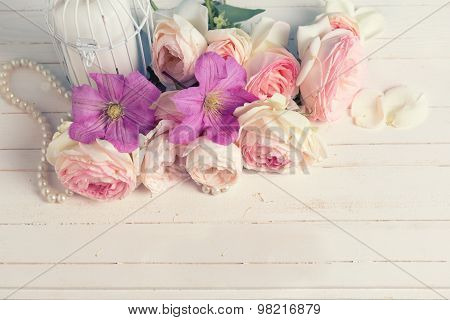 Pink Roses  And Violet Clematis Flowers And Candle