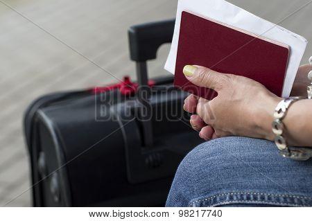 Passport In Female Hands