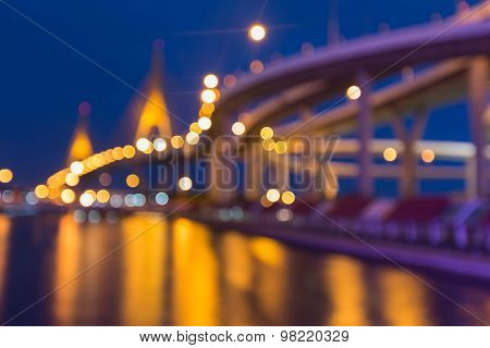 Suspension bridged and highway curved, Blurred bokeh background with water reflection