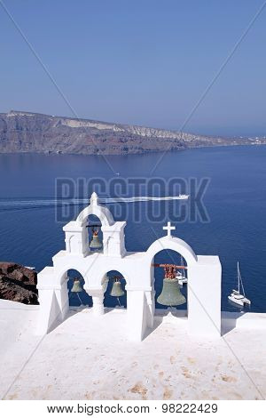 Bell Tower Of White Church Above Blue Sea, Santorini, Greece.