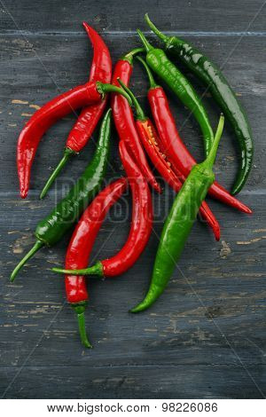 Hot peppers on wooden table close up