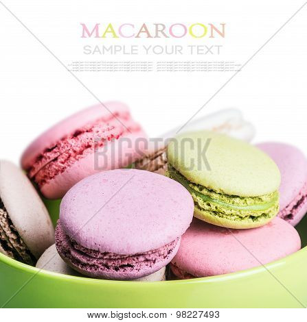 Sweet And Colourful French Macaroons On White