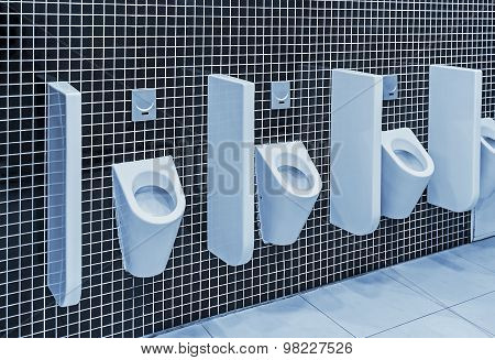 Urinals In A Public Toilet