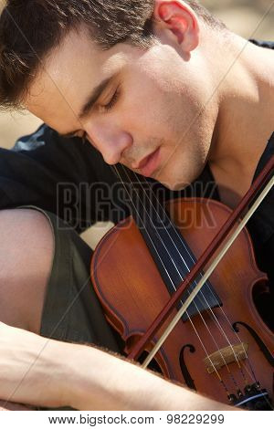 Man Sleeping With His Violin