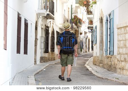 Man Walking With Backpack And Map Lost In Town