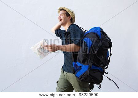 Cheerful Traveling Man Walking With Bag And Map