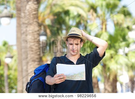Lost Tourist With Bag Holding Map