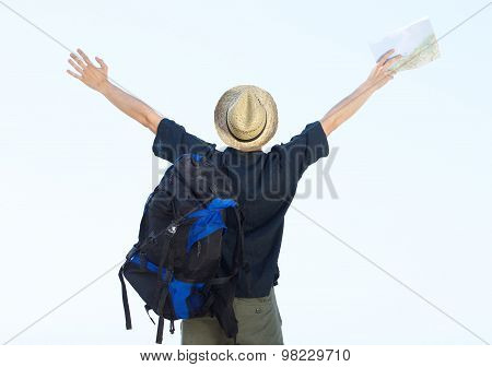 Backpacker Standing With Arms Outstretched