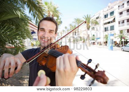 Street Performer Playing Violin Being Paid Money