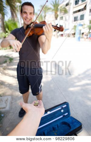 Smiling Male Busker Playing Violin