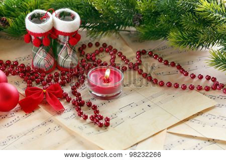 Christmas decorations on music sheets background