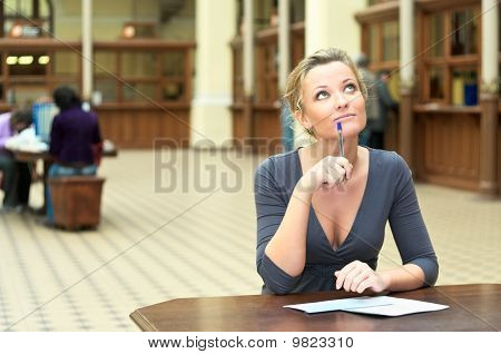 Woman thinking at the desk