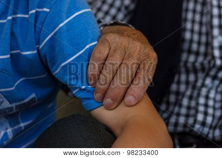 Grandfather's Hand Holding Arm