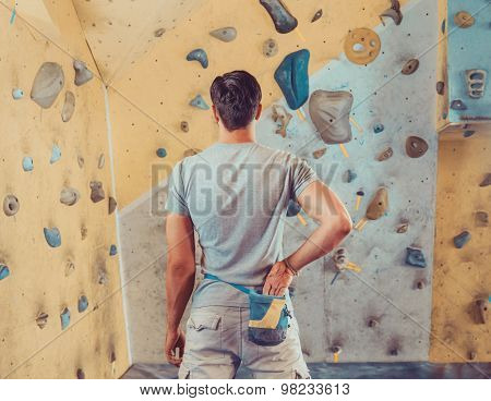 Sporty Man Preparing To Climb